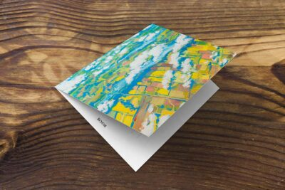 front of greeting card or note card on table, skyscape