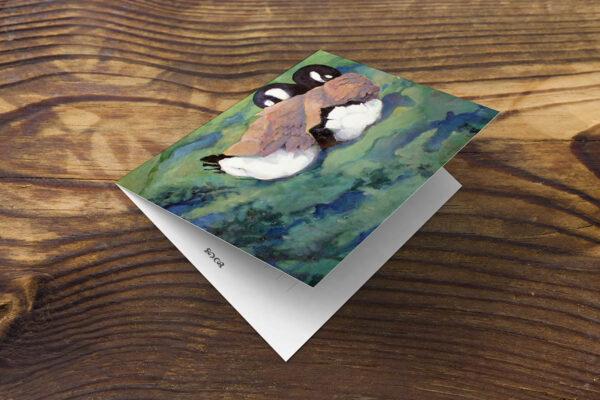 Front of greeting card or note card on table with image of Canada geese