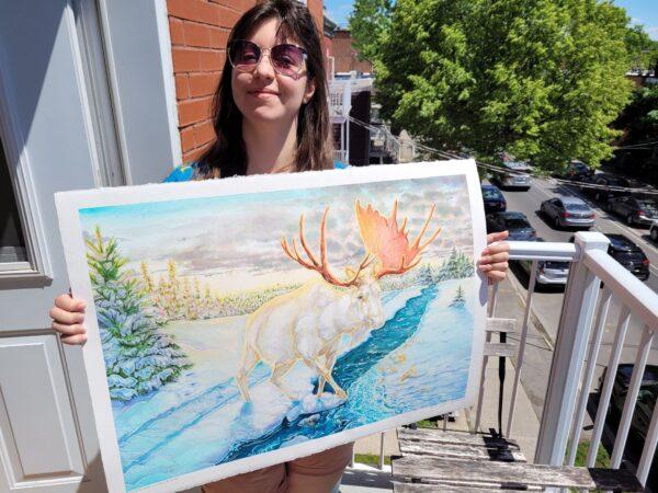 Karolina Szablewska holding up moose painting